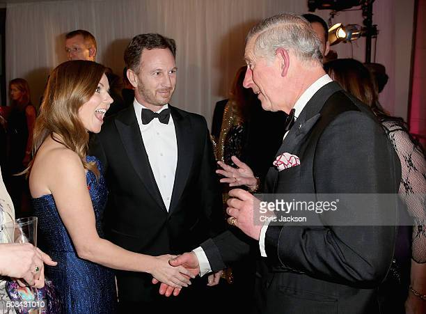 Geri Halliwell and Christian Horner greet Prince Charles Prince of Wales as they attend a predinner reception for the Prince's Trust Invest in...