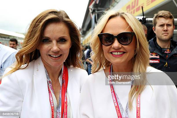 Geri Halliwell and Emma Bunton in the Pitlane before the Formula One Grand Prix of Great Britain at Silverstone on July 10 2016 in Northampton England