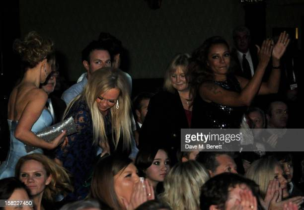 Geri Halliwell, Emma Bunton and Melanie Brown applaud from the audience during the Gala Press Night performance of 'Viva Forever' at the Piccadilly...