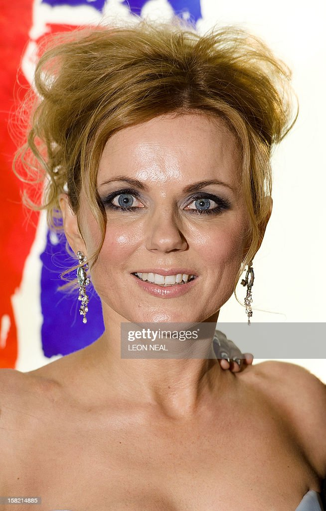 Geri Halliwell, member of the British pop girl group Spice Girls, poses for pictures on the red carpet as she arrives for the premiere of the Spice Girls musical 'Viva Forever' in central London on December 11, 2012. Viva Forever is produced by Judy Craymer, written by Jennifer Saunders and features the music of the Spice Girls. AFP PHOTO/Leon Neal AFP PHOTO/Leon Neal