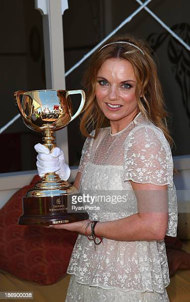 Geri Halliwell poses with the Melbourne Cup during Melbourne Cup Day at Flemington Racecourse on November 5 2013 in Melbourne Australia