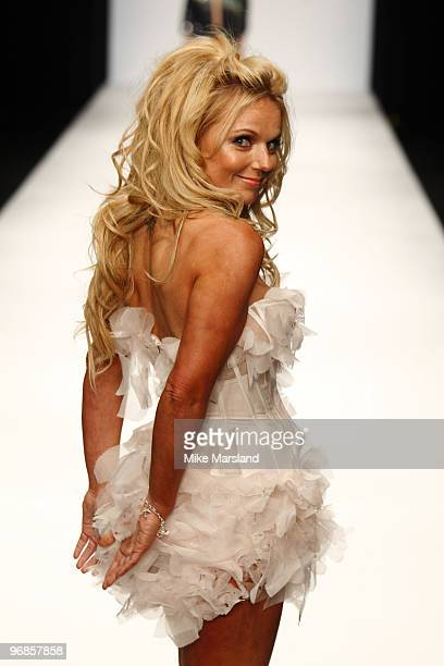 Geri Halliwell walks the runway at the Fashion for Relief show for London Fashion Week Autumn/Winter 2010 at Somerset House on February 18, 2010 in...
