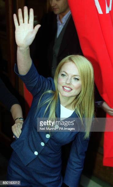 Geri Halliwell waves to fans as she leaves Radio 1's Breakfast show with Zoe Ball after the first radio air play of her new single 'Look at Me'...