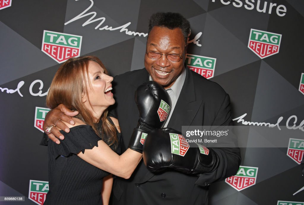 Geri Horner (L) and Larry Holmes attend the launch of the TAG Heuer Muhammad Ali Limited Edition Timepieces at BXR Gym on October 10, 2017 in London, England.