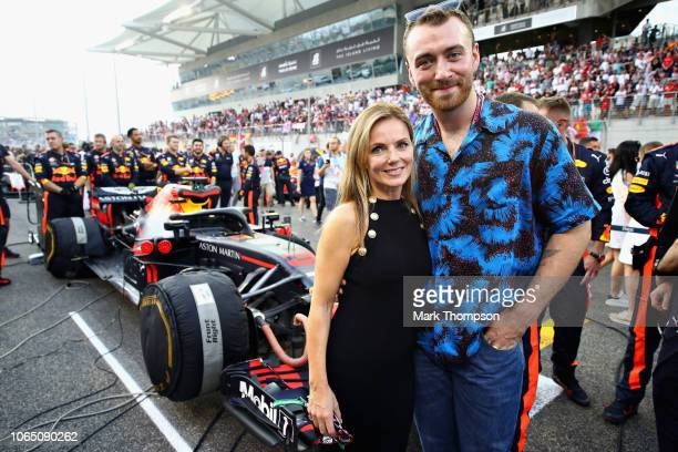 Geri Horner and Sam Smith pose for a photo with the Red Bull Racing team on the grid before the Abu Dhabi Formula One Grand Prix at Yas Marina...