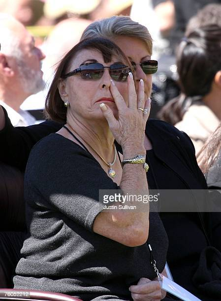 Geri Walsh widow of former 49ers coach Bill Walsh wipes her eye during a public memorial service for Walsh August 10 2007 at Monster Park in San...