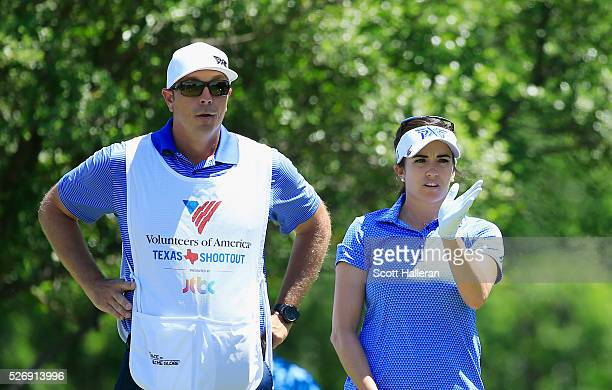 Gerina Piller lines up a shot with her caddie Brian Dilley on the seventh hole during the final round of the Volunteers of America Texas Shootout at...