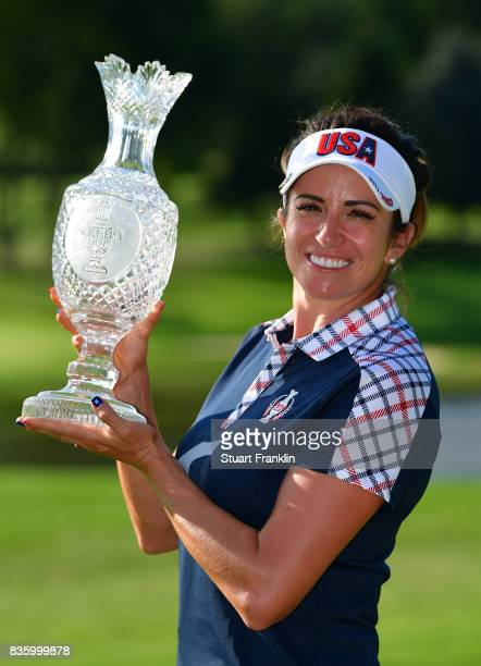 Gerina Piller of Team USA holds the Solheim Cup trophy after the final day singles matches of The Solheim Cup at Des Moines Golf and Country Club on...