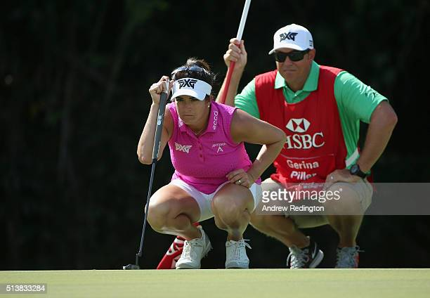 Gerina Piller of the United States lines up a putt with her caddie on the first green during the third round of the HSBC Women's Champions at Sentosa...