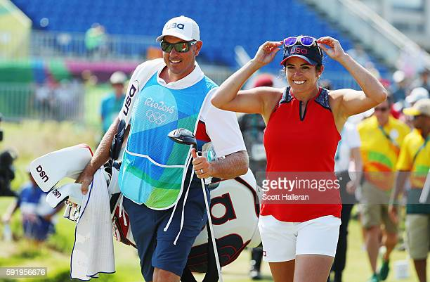 Gerina Piller of the United States walks on the first hole with her caddie Brian Dilley during the third round of the Women's Individual Stroke Play...