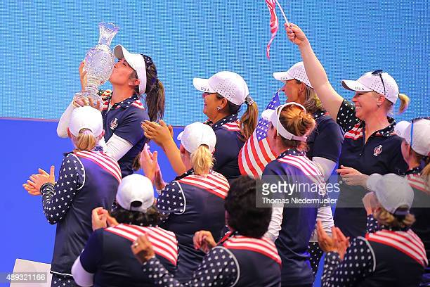 Gerina Piller of the Unitedt States Team kisses the trophy during the closing ceremony at the 2015 Solheim Cup at St LeonRot Golf Club on September...