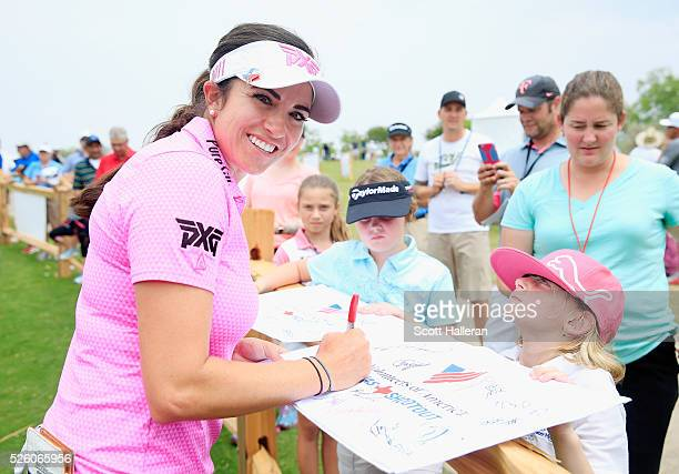 Gerina Piller poses as she signs an autograph for a fan after finishing with a sixunder par 65 during the second round of the Volunteers of America...