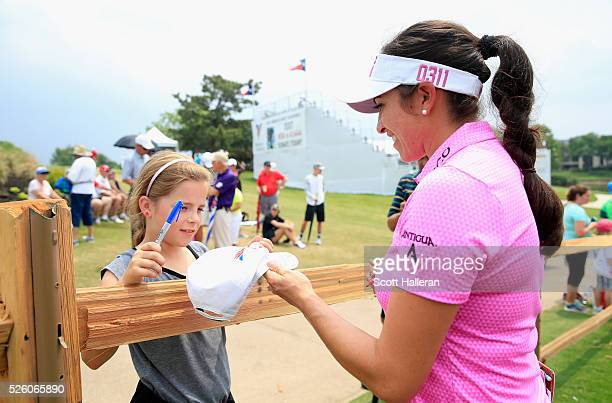 Gerina Piller signs an autograph for a fan after finishing with a sixunder par 65 during the second round of the Volunteers of America Texas Shootout...