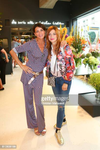 Gerit Kling and Claudia Eisinger attend the 'Kians Garden Flower Shop' Opening Event at Kantstrasse on July 11 2017 in Berlin Germany