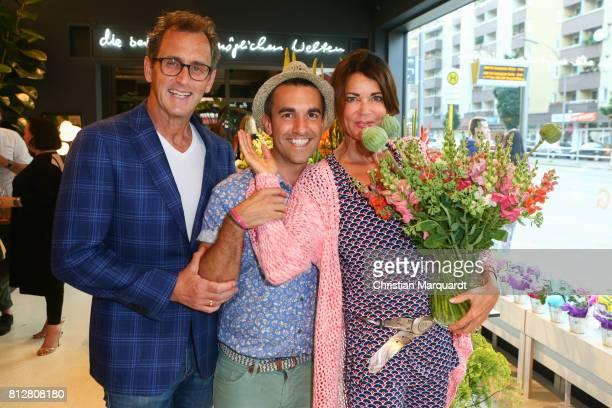 Gerit Kling Stefan Henning and Kian ShamsDolatabadi attend the 'Kians Garden Flower Shop' Opening Event at Kantstrasse on July 11 2017 in Berlin...