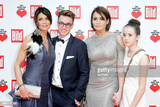 Gerit Kling with her son Leon and her sister Anja Kling with her daughter Alea attend the 'Ein Herz fuer Kinder Gala' at Studio Berlin Adlershof on...