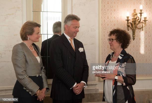 Gerlinde Kretschmann wife of Winfried Kretschmann premier of German state BadenWuerttemberg talks to Friedrich Duke of Wuerttemberg and Marie Duchess...