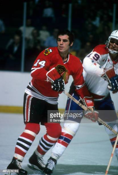 Germain Gagnon of the Chicago Blackhawks skates on the ice as he is defended by Jack Lynch of the Washington Capitals on February 25 1975 at the...
