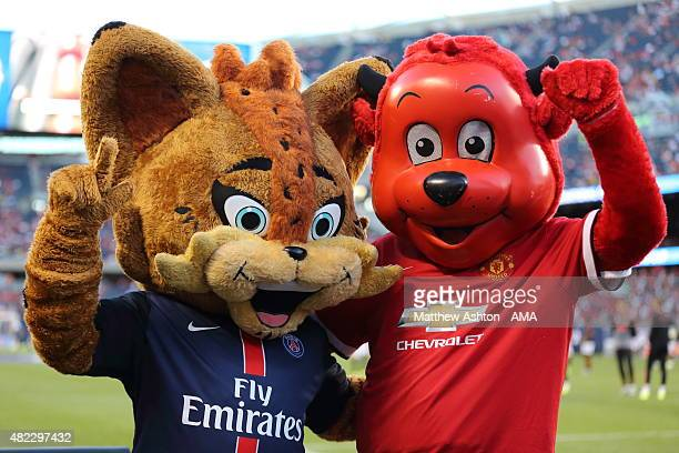 Germain le Lynx the mascot of PSG and Fred The Red the Manchester Untied mascot before the International Champions Cup match between Manchester...