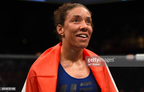 Germaine de Randamie of The Netherlands celebrates her victory over Holly Holm in their women's featherweight championship bout during the UFC 208...