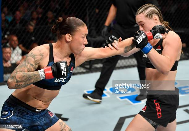 Germaine de Randamie of the Netherlands punches Aspen Ladd in their women's bantamweight bout during the UFC Fight Night event at Golden 1 Center on...