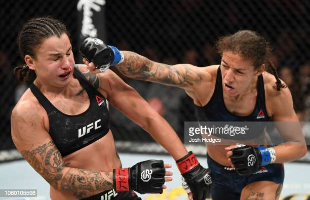 Germaine de Randamie of The Netherlands punches Raquel Pennington in their women's bantamweight bout during the UFC Fight Night event inside Pepsi...