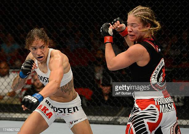 Germaine de Randamie punches Julie Kedzie in their bantamweight bout during the UFC on FOX event at Key Arena on July 27 2013 in Seattle Washington
