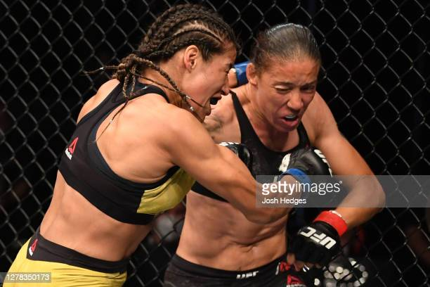 Germaine de Randemie of The Netherlands punches Julianna Pena in their women's bantamweight bout during the UFC Fight Night event inside Flash Forum...