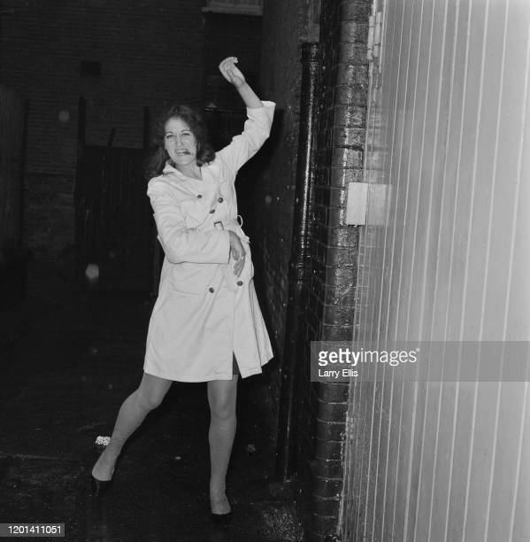 Germaine Greer poses at the Lyric Theatre where she is appearing in 'My Girl Herbert', in Hammersmith, London, England, 12th July 1965.