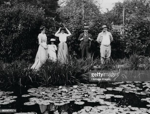 Germaine HoschedÈ Lili Butler Mme Joseph DurandRuel Georges DurandRuel and Claude Monet at the water lily pond in Giverny 1900 Found in the...