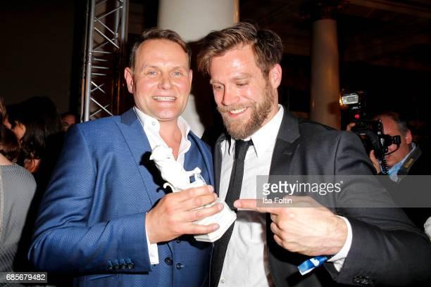 German actor and award winner Devid Striesow and German actor Ken Duken during the Bayerischer Fernsehpreis 2017 at Prinzregententheater on May 19...