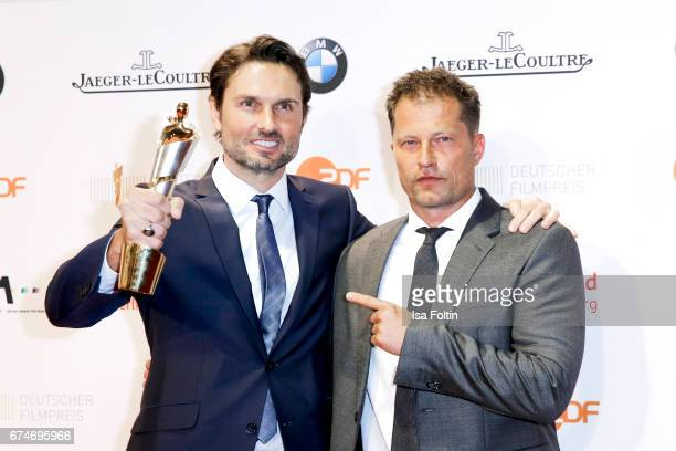 German actor and award winner for best film Simon Verhoeven and laudator and german actor Til Schweiger at the Lola German Film Award winners board...