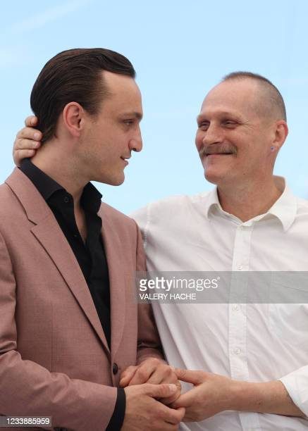 """German actor and dancer Franz Rogowski and Austrian actor Georg Friedrich pose during a photocall for the film """"Great Freedom"""" as part of the Un..."""