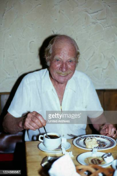 German actor and dubbing actor Gustl Datz having a meal, Germany, 1970s.