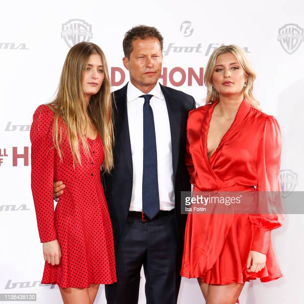German actor and producer Til Schweiger with his daughters Lilli Schweiger and Luna Schweiger during the Head full of Honey premiere at Zoo Palast on...