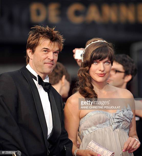 German actor and singer Campino and Ukrainian model and actress Milla Jovovich pose as they arrive to attend the screening of German director Wim...