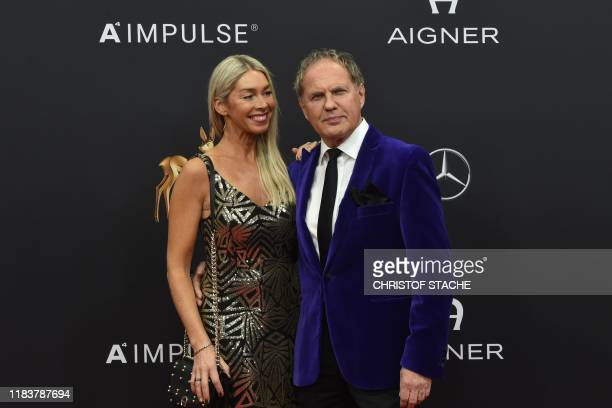 German actor and singer Uwe Ochsenknecht and his partner Kiki Viebrock pose on the red carpet before the Bambi media prize ceremony on November 21...