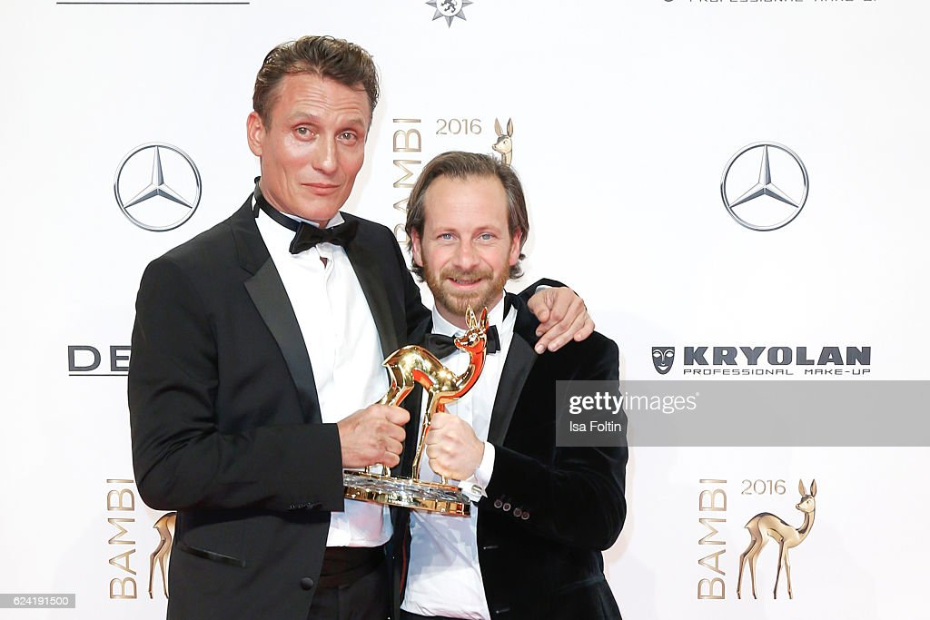 German actor and ward winners Oliver Masucci and Fabian Busch during the Bambi Awards 2016 at Stage Theater on November 17, 2016 in Berlin, Germany.
