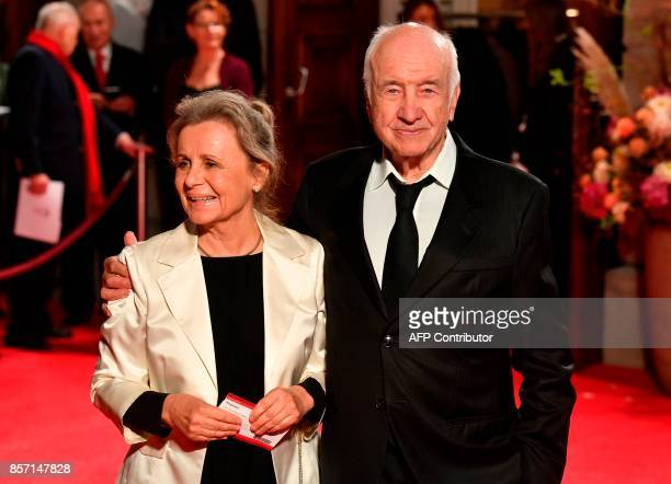 German actor Armin Mueller Stahl and his wife Gabriele Scholz pose for photographers ahead the reopening of the State Opera in Berlin on October 3...
