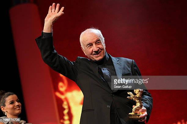 German actor Armin MuellerStahl holds the Golden Honorary Bear at the 'Music Box' Premiere during day nine of the 61st Berlin International Film...