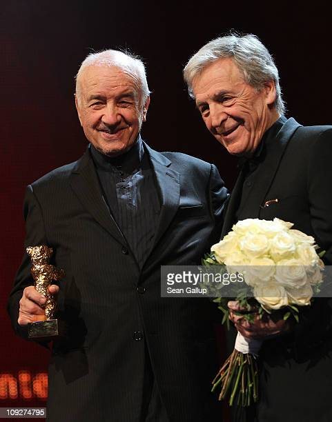 German actor Armin MuellerStahl holds the Golden Honorary Bear award next to Greek director CostaGavras at the 'Music Box' Premiere during day nine...