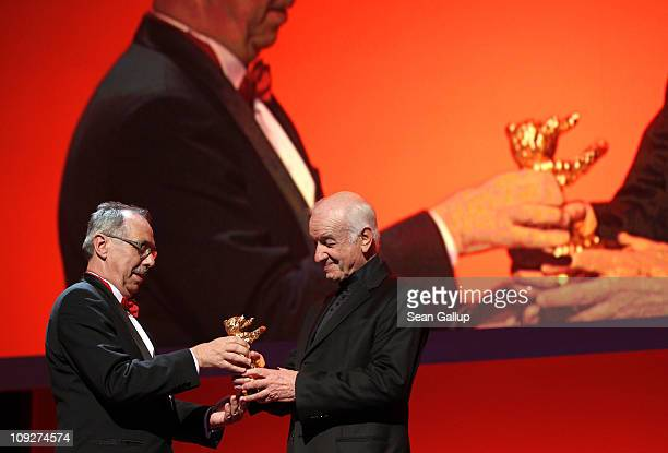 German actor Armin MuellerStahl receives the Golden Honorary Bear from festival director Dieter Kosslick at the 'Music Box' Premiere during day nine...