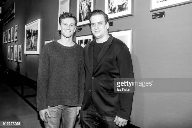 German actor Artjom Gilz and Dominik Elstner during the exhibition opening 'PortrAid Get art Give work' at DRIVE Volkswagen Group Forum on February...