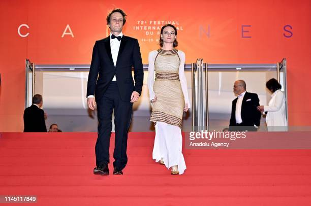 German actor August Diehl and Austrian actress Valerie Pachner leave after the screening of the film 'A Hidden Life' at the 72nd annual Cannes Film...