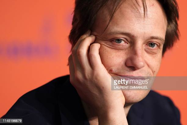 German actor August Diehl attends a press conference for the film A Hidden Life at the 72nd edition of the Cannes Film Festival in Cannes southern...