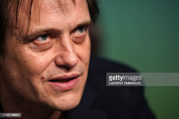 German actor August Diehl speaks during a press conference for the film A Hidden Life at the 72nd edition of the Cannes Film Festival in Cannes...