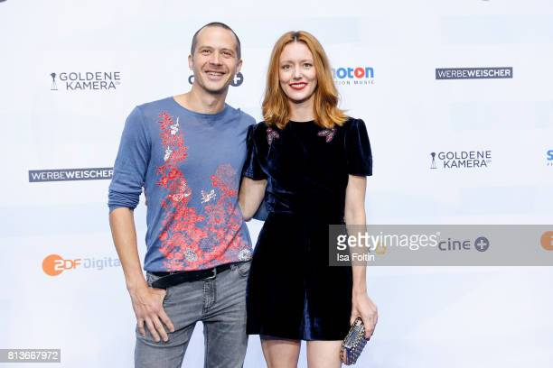 German actor Barnaby Metschurat and his girlfriend German actress Lavinia Wilson attend the summer party 2017 of the German Producers Alliance on...