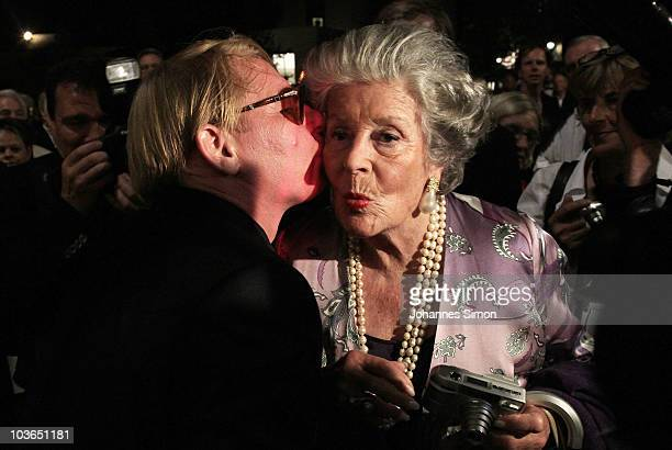 German actor Ben Becker kisses Countess Marianne zu SaynWittgensteinSayn after the Pakistan Benefit Concert at Haus fuer Mozart cponcert hall on...