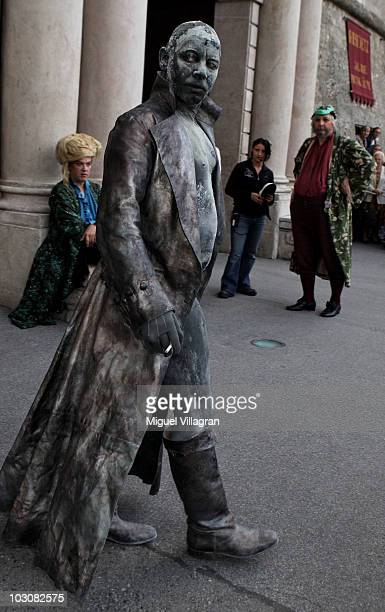 German actor Ben Becker smokes a cigarette prior to the premiere of the play 'Jedermann' during the opening of the Salzburg Festival on July 25 2010...