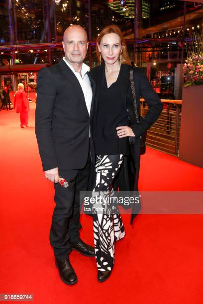German actor Christian Berkel and his wife German actress Andrea Sawatzki attend the opening party of the 68th Berlinale International Film Festival...